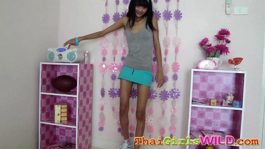 Petite Asian Girl Strips