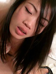 Very pretty amateur Thai girl named Gitar takes cum in her mouth