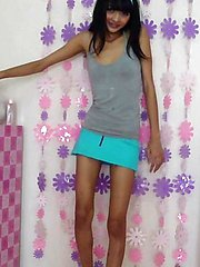 Petite Thai girl Eaw strips from her cute teen outfit