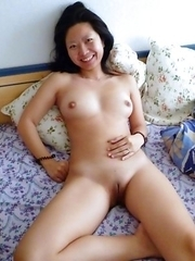 Wild Chinese babe posing naked outdoors